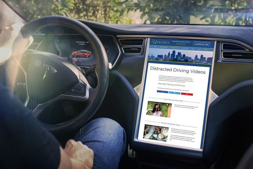 Injury Lawyer Website Distracted Driving Videos in a Tesla